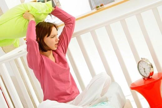 WOMAN WAKING UP. WOMAN WAKING UP Model. : Stock Photo