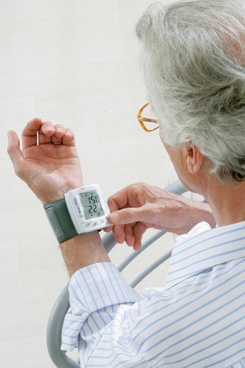 BLOOD PRESSURE, ELDERLY PERSON. BLOOD PRESSURE, ELDERLY PERSON Model. : Stock Photo
