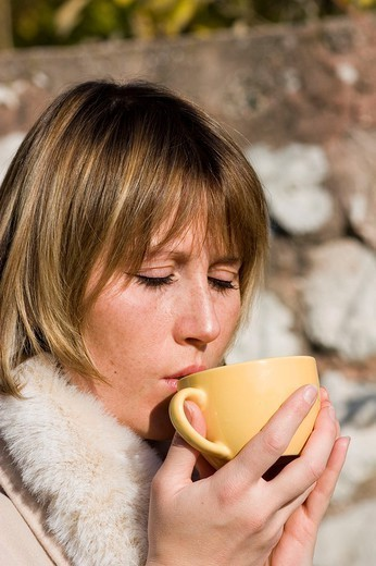 Stock Photo: 824-96933 WOMAN WITH HOT DRINK. WOMAN WITH HOT DRINK