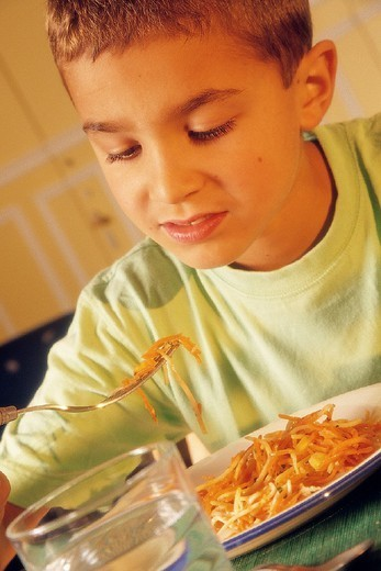 CHILD EATING A MEAL. CHILD EATING A MEAL Model. : Stock Photo