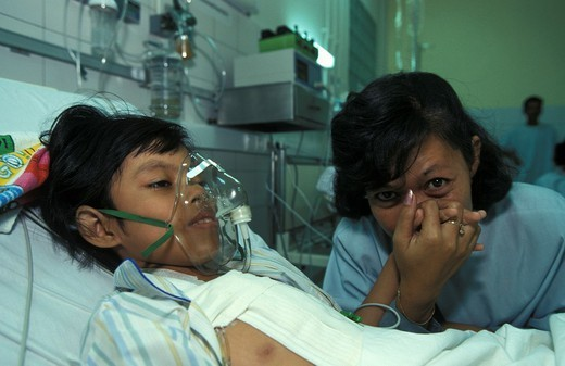 MEDICINE CAMBODIA. MEDICINE CAMBODIA Photo essay from hospital. Mother and daughter in the intensive care unit at the Calmette hospital, Cambodia. : Stock Photo