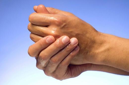 HAND WASHING. Application of alcohol hand rub. Rub palm to palm. : Stock Photo