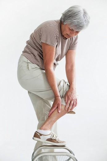 Stock Photo: 824R-13524 LEG PAIN IN AN ELDERLY PERSON