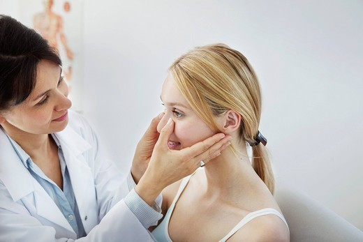 Stock Photo: 824R-13581 EAR NOSE & THROAT, WOMAN