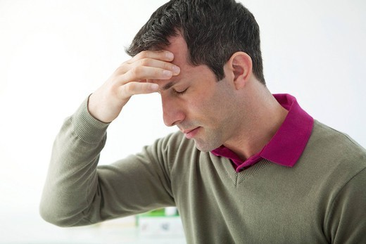 MAN WITH HEADACHE : Stock Photo