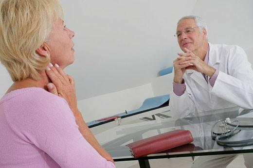 HOSPITAL CONSULTATION ELDERLY P. Models. : Stock Photo