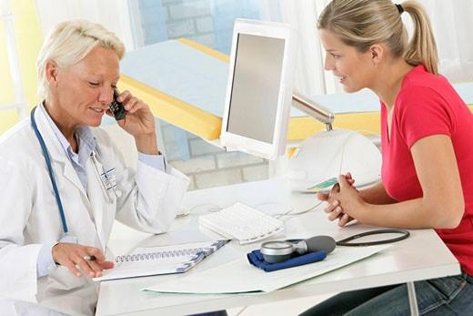 Stock Photo: 824R-5853 WOMAN AT HOSPITAL CONSULTATION Models.