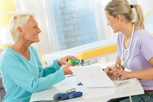 ELDERLY PERSON IN CONSULTATION Models. : Stock Photo