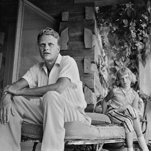 Stock Photo: 857-1203 USA, North Carolina, Montreat, Billy Graham and his daughter, Anne, then age 10, at their home, September 1958