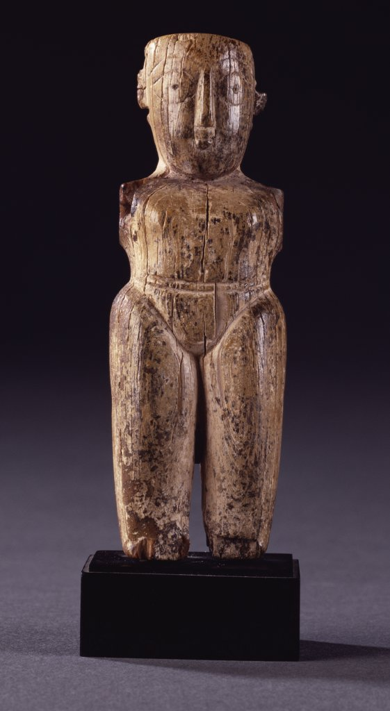Stock Photo: 866-7725 A Fatamid ivory male figurine with stocky body, lightly delineated loincloth and large head carved with almond shaped eyes. Circa 11th century, 11.1cm high.