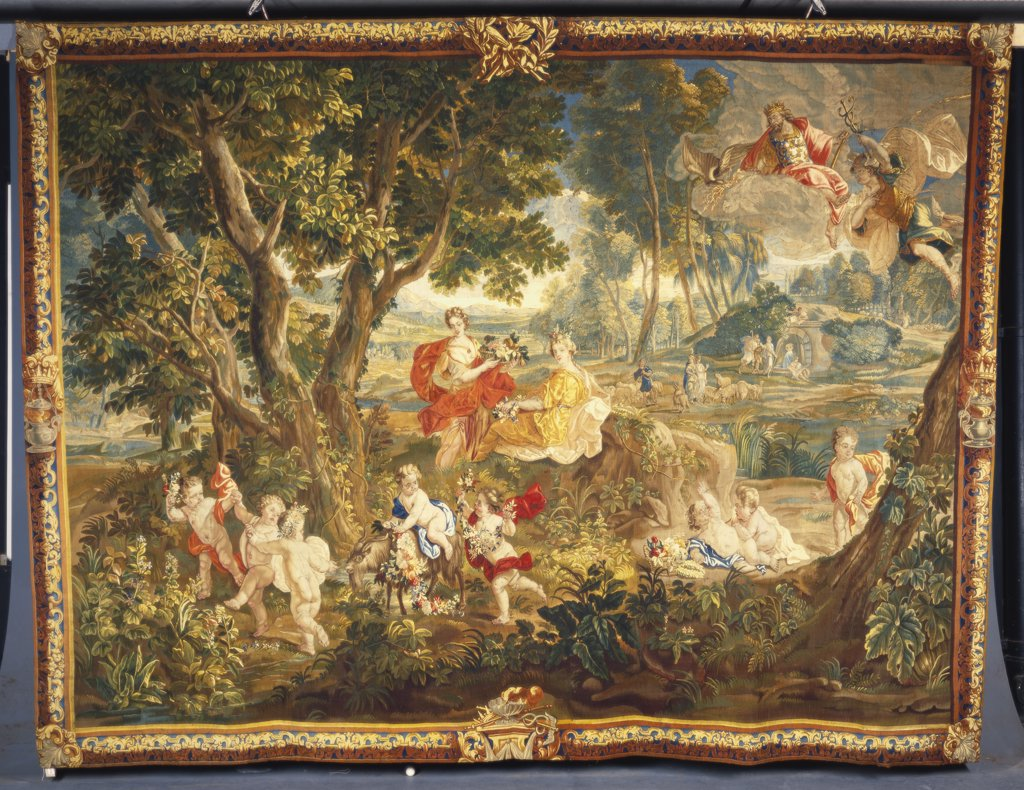 Stock Photo: 866-7928 A Gobelins tapestry, woven in wools and silks, depicting Des Enfants Jardiniere frolicking with a Goat and Flowers. Early 18th century, 333 x 452cm.