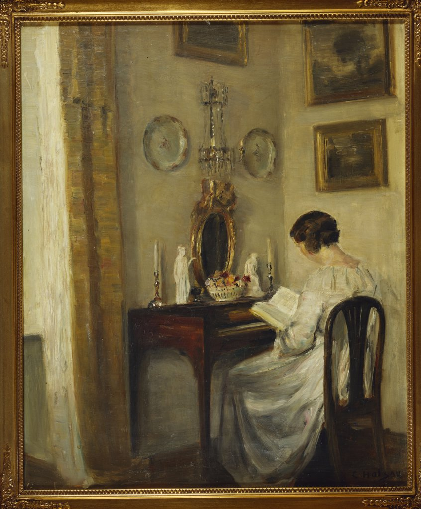 An Interior with a Girl Reading at a Desk. Carl Holsoe (1863-1935). Oil on canvas, 57.8 x 47.8cm. : Stock Photo