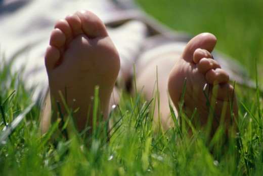 Stock Photo: 867R-1251 Close-up of the sole of a person's feet lying on grass