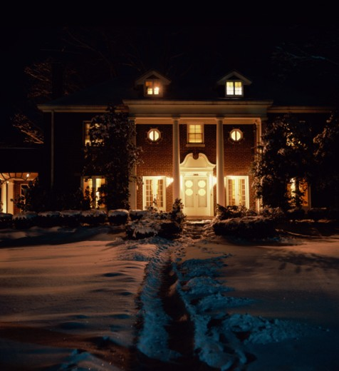 House lit up at night : Stock Photo