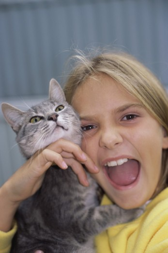 Portrait of a girl playing with her cat : Stock Photo