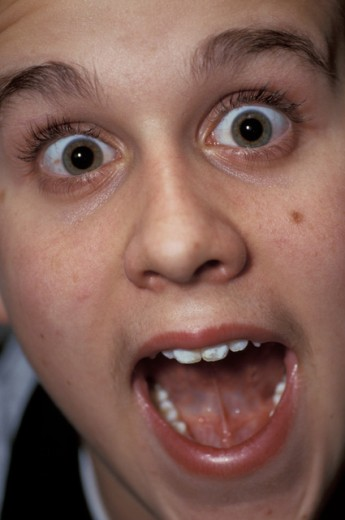 Stock Photo: 867R-1609 Portrait of a teenage boy screaming