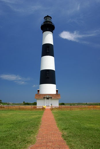 Path in front of a lighthouse, Bodie Island Lighthouse, Cape Hatteras National Seashore, North Carolina, USA : Stock Photo