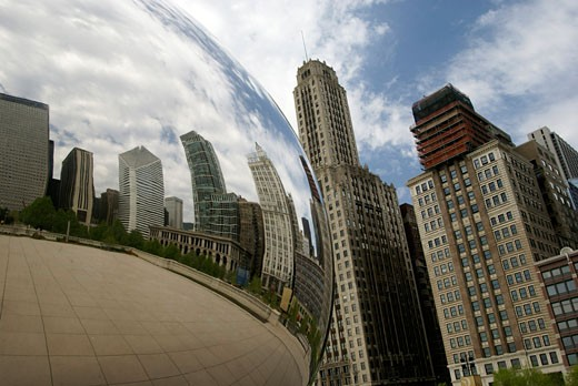 Buildings reflected in a sculpture, Cloud Gate, Millennium Park, Chicago, Illinois, USA : Stock Photo