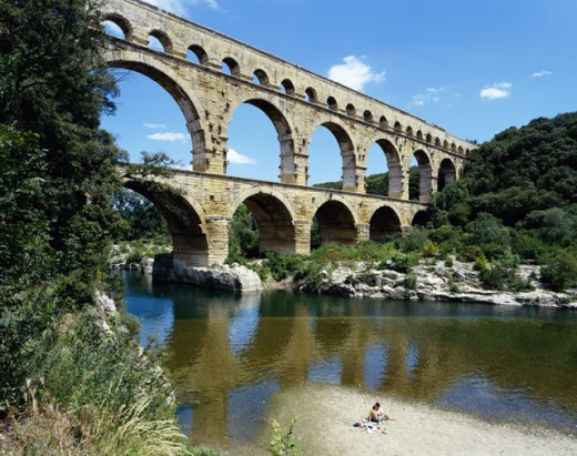 Reflection of an aqueduct in water, Pont du Gard, Nimes, France : Stock Photo
