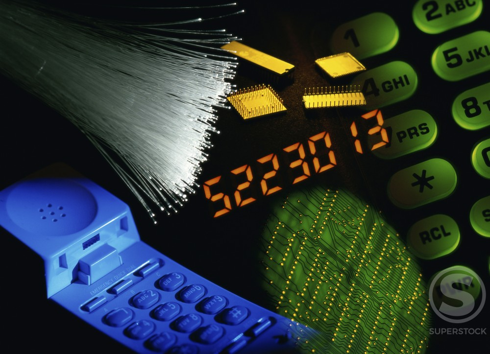 Stock Photo: 882-1089 Fiber optics with computer chips and a cordless phone