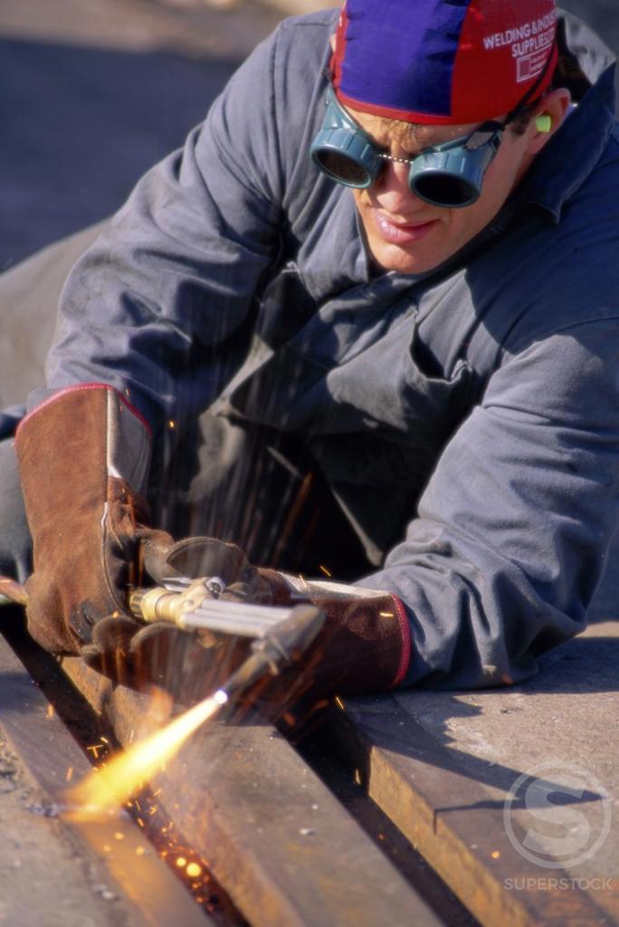 Stock Photo: 882-142A Welder welding an iron rod