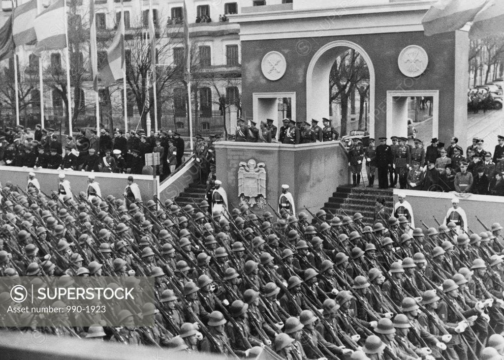 Stock Photo: 990-1923 Francisco Franco on platform overlooking military parade, Second anniversary of the Dia de la Victoria, Madrid, Spain, April 1, 1941