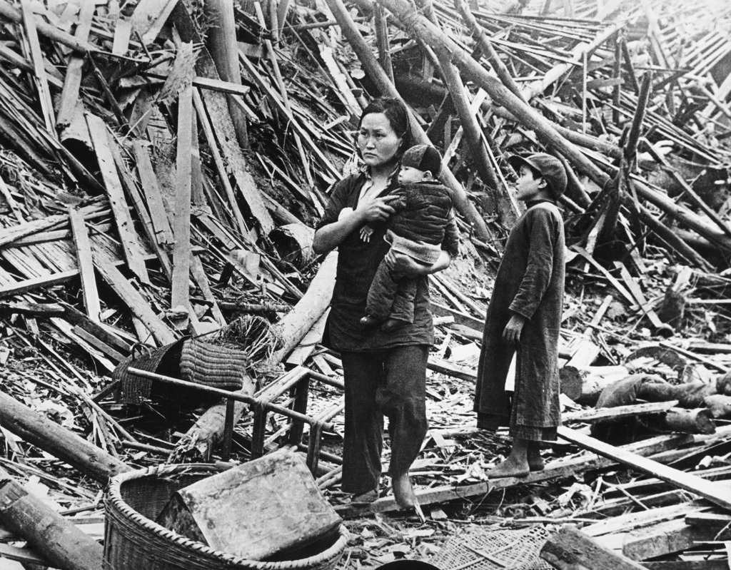 Stock Photo: 990-118123 Mother standing with her two children among the air raid ruins, Chongqing, China