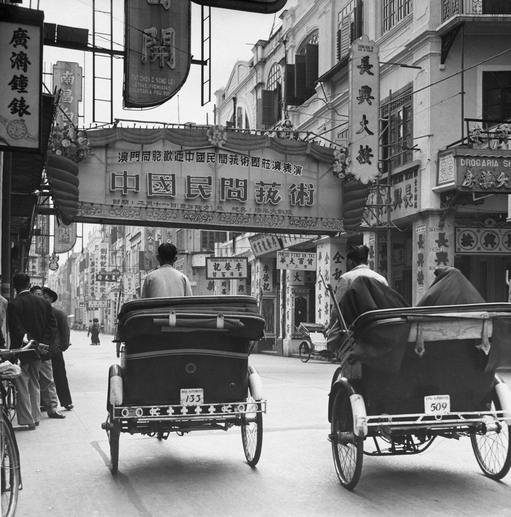 Pedicabs in a market street, Avenida de Almeida Ribeiro, Macao, China : Stock Photo
