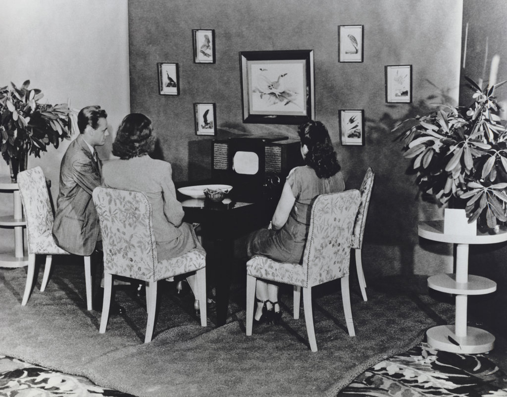 Stock Photo: 990-2075 Family Watching Television on RCA's First Commercially Produced Black-and-White Television Set (Model 630TS) - Ca. 1946