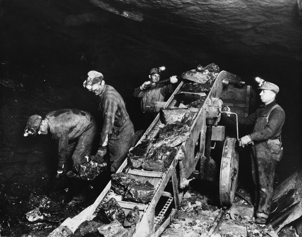 Stock Photo: 990-2166 High angle view of four miners working in a pit mine, Pennsylvania, USA