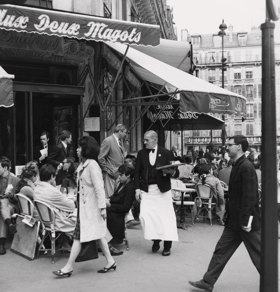 Stock Photo: 990-2182 Group of people sitting in a sidewalk cafe, Aux Deux Magots, Paris, France