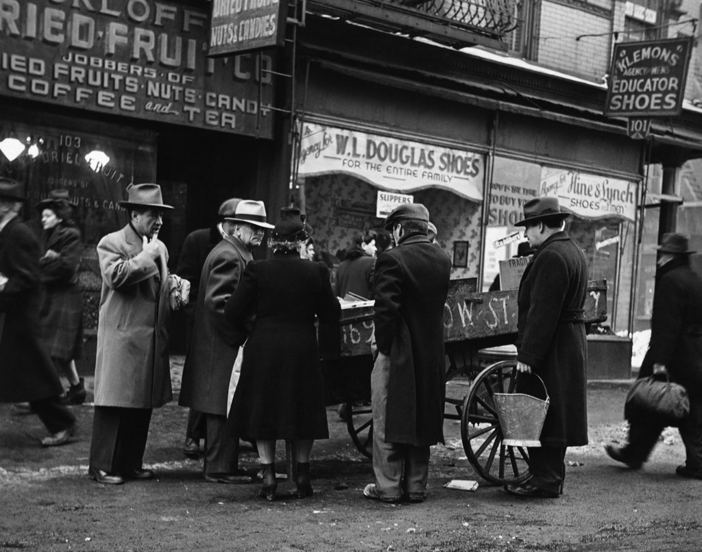 Stock Photo: 990-2206 Group of people near a street vendor, New York City, New York, USA