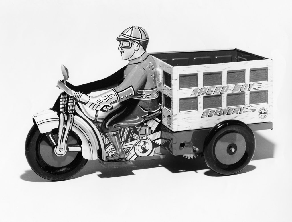 Stock Photo: 990-2607 Side profile of a male figurine driving a Mechanical Delivery Motorcycle, 1930