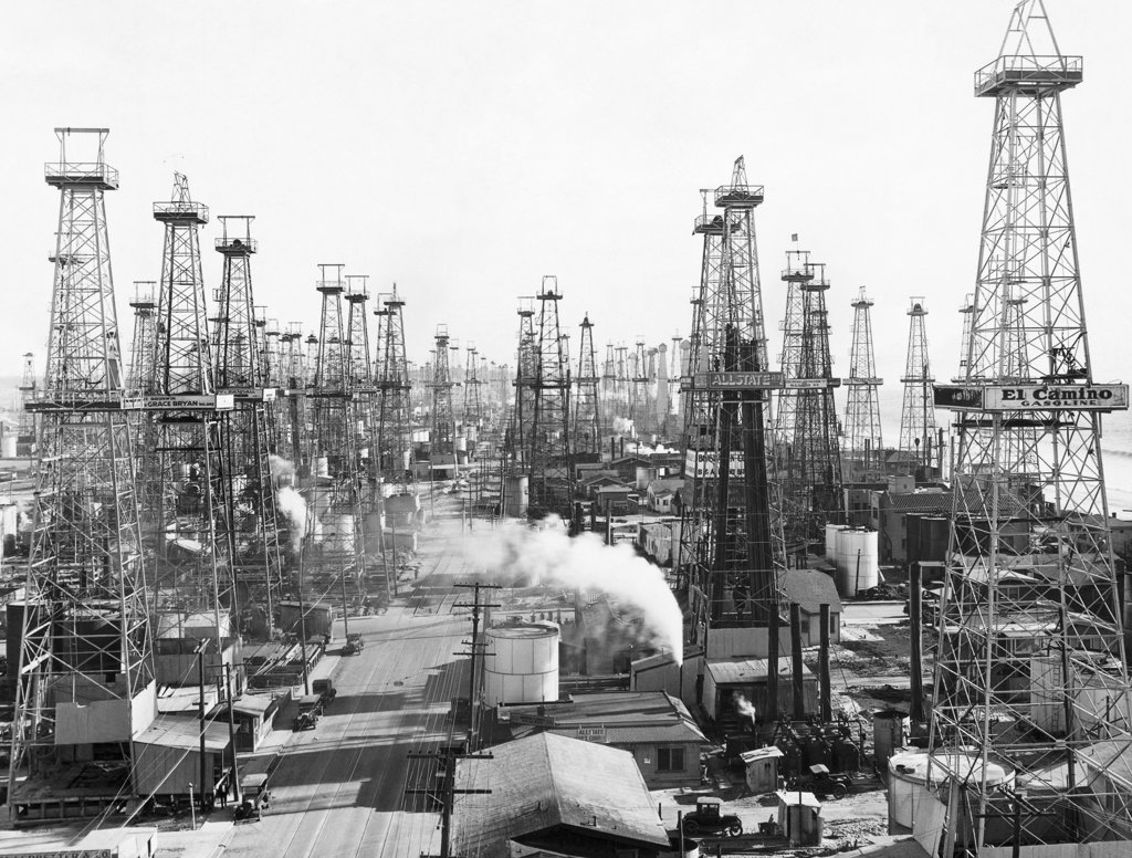 Oil drilling rigs in an oil refinery, California, USA : Stock Photo