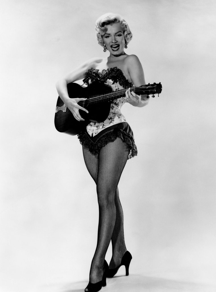 Stock Photo: 990-2790 Marilyn Monroe playing guitar