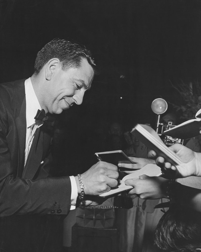 Stock Photo: 990-3461 Actor Jack Webb signing autographs