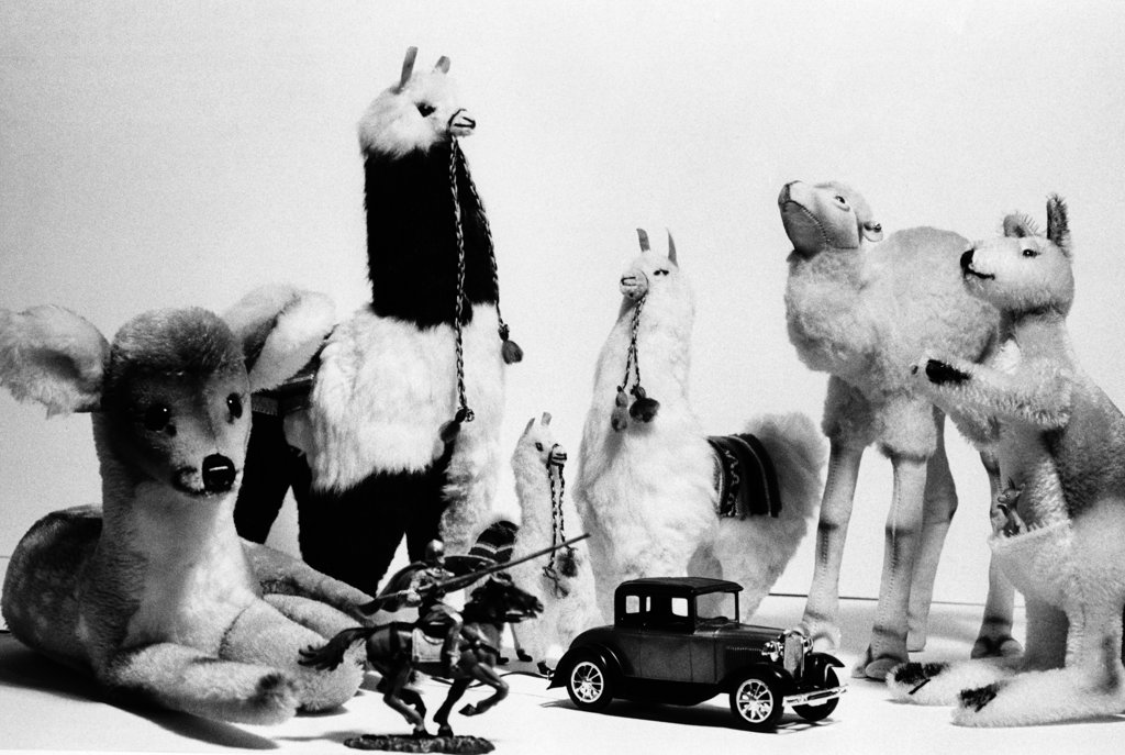 Close-up of a group of stuffed toys with a toy car : Stock Photo