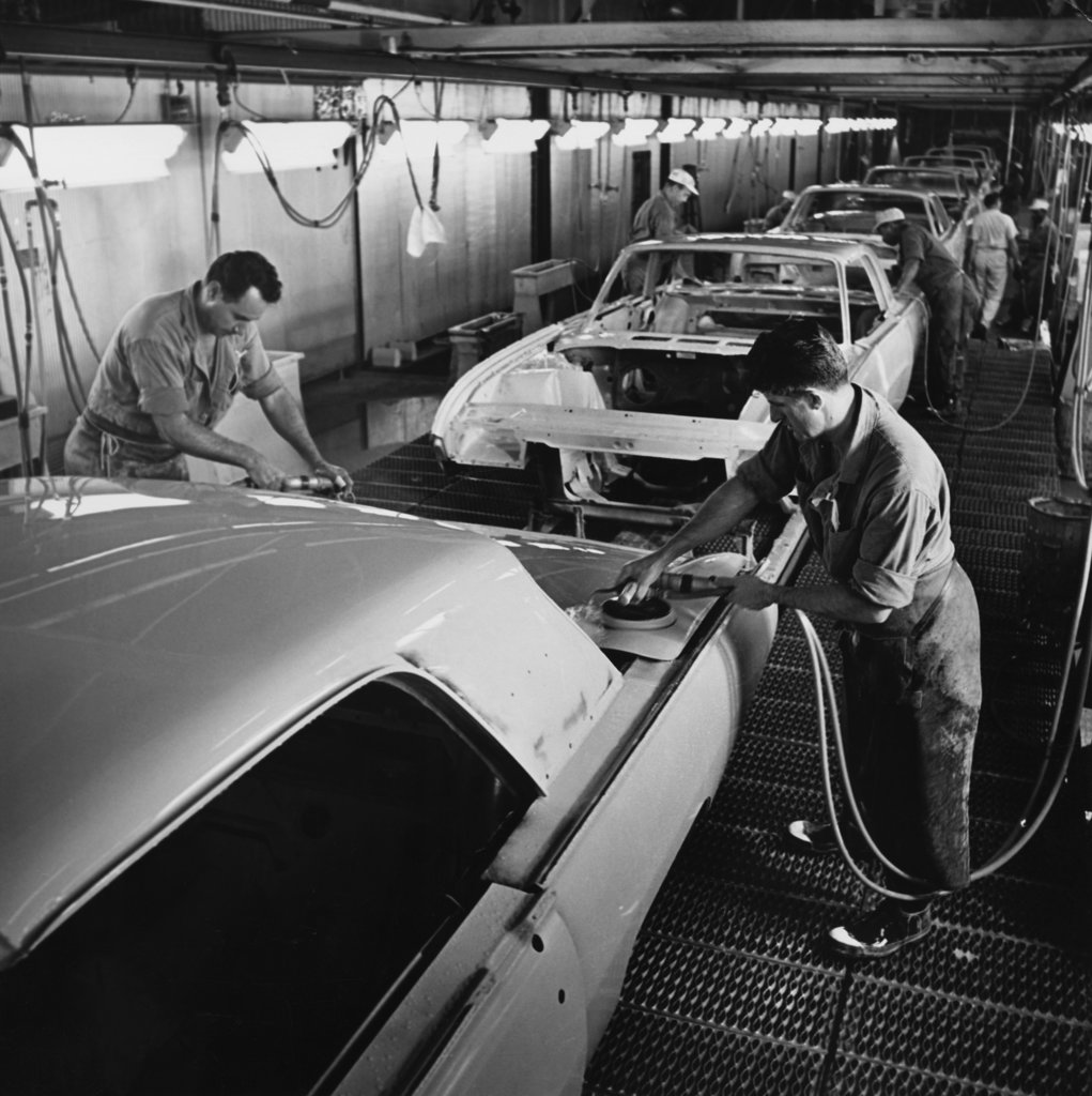 Stock Photo: 990-4452 Two male workers working in a car assembly plant
