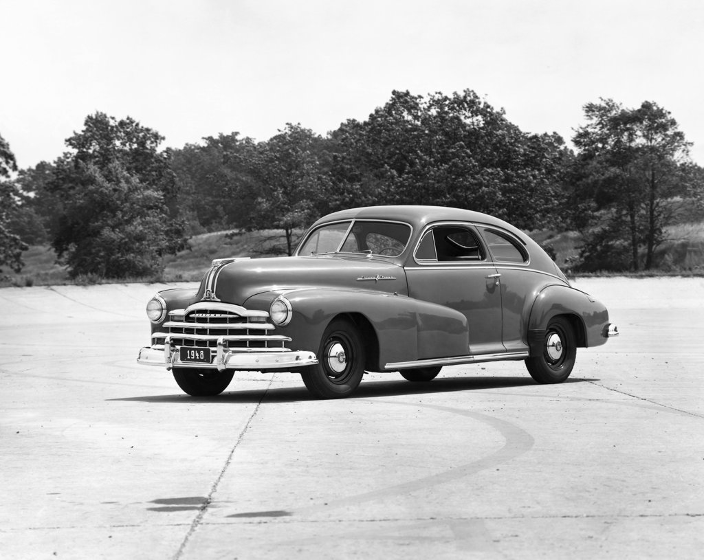 Stock Photo: 990-977 Car parked in front of trees, Pontiac, 1948